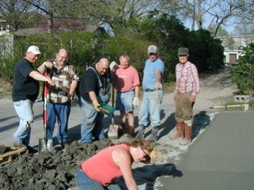 Helen Andersen shows the men how to finish concrete!!  She sings too!